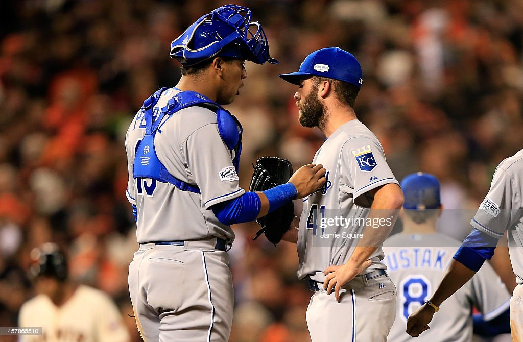 Salvador Perez #13 talks with <a gi-track='captionPersonalityLinkClicked' href=/galleries/search?phrase=Danny+Duffy&family=editorial&specificpeople=5971971 ng-click='$event.stopPropagation()'>Danny Duffy</a> #41 of the Kansas City Royals in the fifth inning against the San Francisco Giants during Game Four of the 2014 World Series at AT&T Park on October 25, 2014 in San Francisco, California.