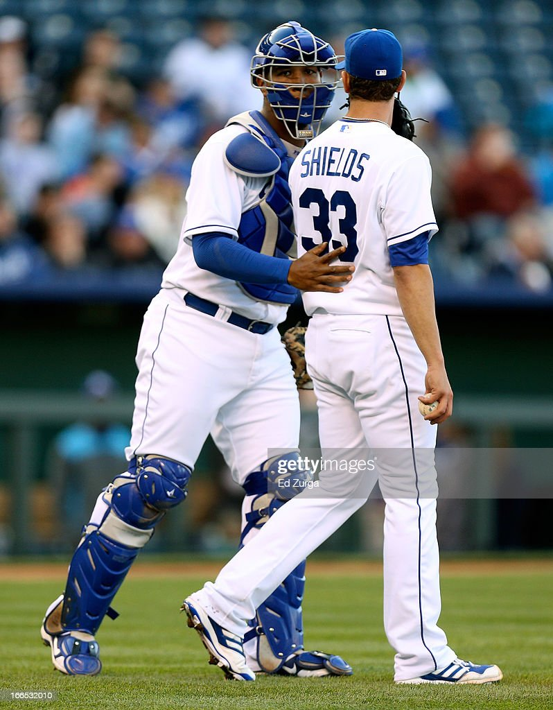 Salvador Perez #13 talks with James Shields #33 starting pitcher of the Kansas City Royals during a game against the Toronto Blue Jays in the third inning at Kauffman Stadium April 13, 2013 in Kansas City, Missouri.