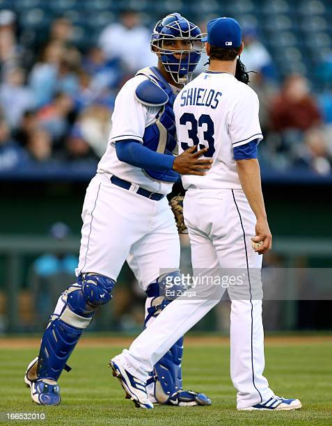 Salvador Perez talks with James Shields starting pitcher of the Kansas City Royals during a game against the Toronto Blue Jays in the third inning at...