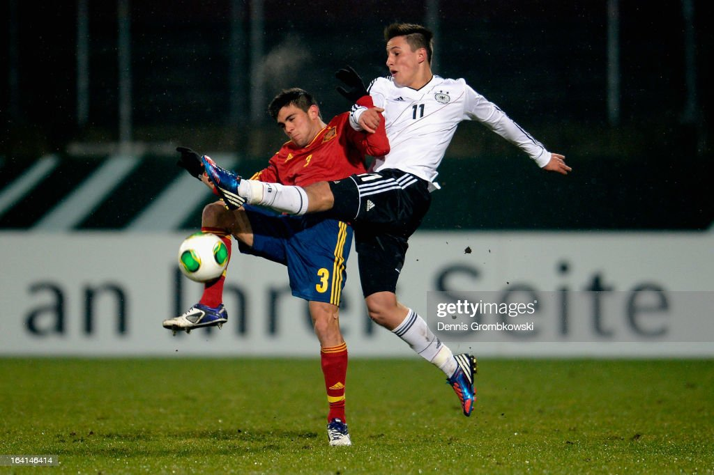 Salvador Ruiz of Spain is challenged by <a gi-track='captionPersonalityLinkClicked' href=/galleries/search?phrase=Fabian+Schnellhardt&family=editorial&specificpeople=5863646 ng-click='$event.stopPropagation()'>Fabian Schnellhardt</a> of Germany during the International Friendly match between U19 Germany and U19 Spain on March 20, 2013 in Duesseldorf, Germany.