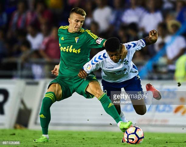 Salvador Sanchez 'Salvi' of Cadiz competes for the ball with Anthony Lozano of CD Tenerife during La Liga 2 play off round between CD Tenerife and at...