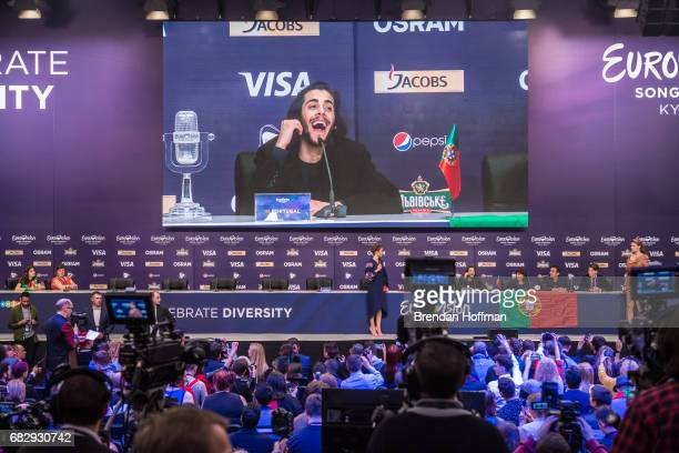 Salvador Sobral the winning contestant from Portugal is seen on a large screen during the winner's press conference at the Eurovision Grand Final on...