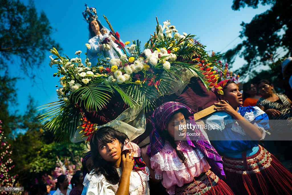 Salvadoran girls carry an altar with a statue of Virgin Mary during the procession of the Flower & Palm Festival in Panchimalco, El Salvador, 8 May 2011. On the first Sunday of May, the small town of Panchimalco, lying close to San Salvador, celebrates its two patron saints with a spectacular festivity, known as Fiesta de las Flores y Palmas. The origin of this event comes from pre-Columbian Maya culture and used to commemorate the start of the rainy season. Women strip the palm branches and skewer flower blooms on them to create large colorful decoration. In the afternoon procession, lead by a male dance group performing a religious dance-drama inspired by the Spanish Reconquest, large altars adorned with flowers are slowly carried by women, dressed in typical costumes, through the steep streets of the town.