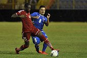 Salvadoran player Jaime Alas fights for the ball with Oloughlin Errol from St Kitts y Nevis during a FIFA World Cup Russia 2018 CONCACAF qualifying...