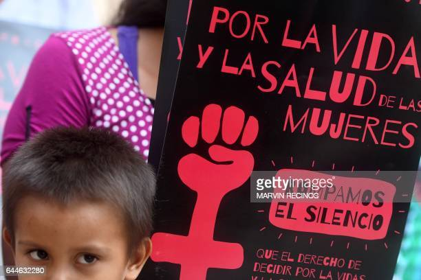 Salvadoran women and children take part in a demonstration to demand the decriminalization of abortion outside the Legislative Assembly in San...