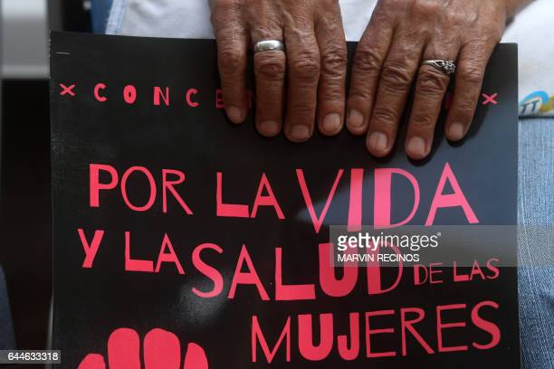 Salvadoran women take part in a demonstration to demand the decriminalization of abortion outside the Legislative Assembly in San Salvador on...