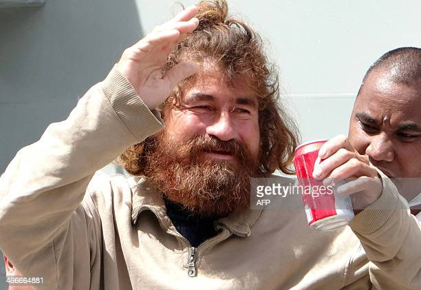 A Salvadorean castaway who identified himself as Jose Ivan and later told that his full name is Jose Salvador Alvarenga walks with the help of a...