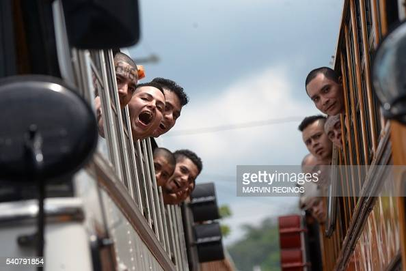 TOPSHOT Salvadorean gang members look out from the bus window while being transferred from Cojutepeque prison to mediumsecurity prisons in the town...