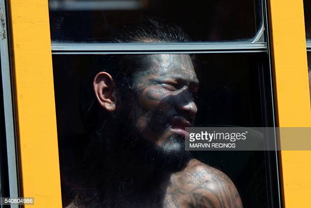 Salvadorean gang members look out from the bus window while being transferred from Cojutepeque prison to mediumsecurity prisons in the town of...