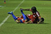 Salvadorean player Xavier Garcia fights for the ball with Sawyers Romaine from St Kitts y Nevis during a CONCACAF qualifying match for the Russia...