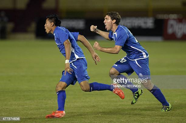 Salvadorean players Darwin Ceren and Pablo Punyed celebrate after scoring against St Kitts and Nevis during a CONCACAF qualifying match for the...