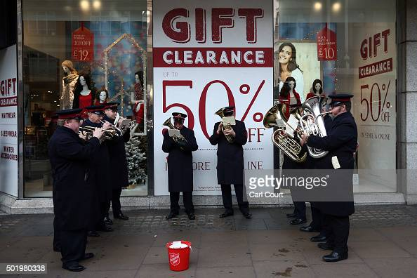 Salvation Army band play under a sale sign on Oxford Street on December 19 2015 in London England Shoppers have taken to the high street on the last...