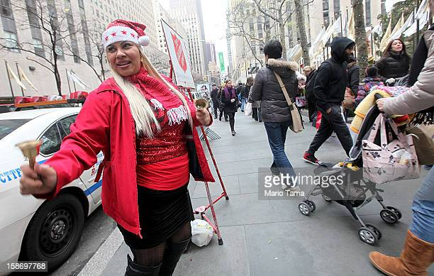 Salvation Army bell ringer Alicia Rivera dances at Rockefeller Center on Christmas Eve on December 24 2012 in New York City Christians around the...