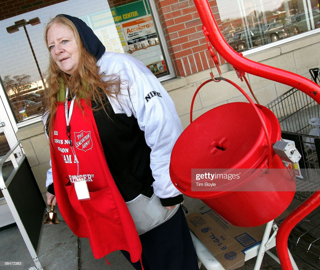 Salvation Army bell ringer Debra Vazquez works near her red Holiday donation kettle December 20 2005 in Park Ridge Illinois Since 1865 the Salvation...