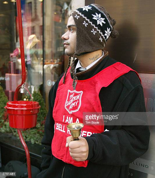 Salvation Army bell ringer Ruben Rios works outside a store November 21 2003 on the Magnificent Mile in Chicago Funds raised through the Chicagoland...