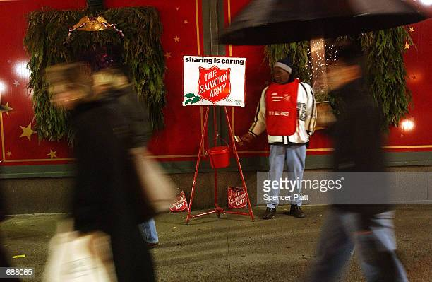 Salvation Army bell ringer stands on a street waiting for donations to the charity December 17 2001 in New York City Since the September 11 terrorist...