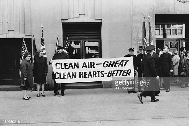 Salvation Army members carry a sign reading 'Clean Air Great Clean Hearts Better' outside their Headquarters on West 14th Street Greenwich Village...