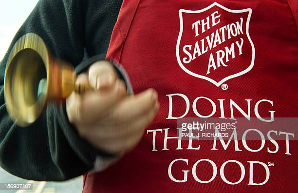 Salvation Army volunteer Bubba Wellens rings the collection bell outside a Giant grocery store November 24 in Clifton Virgina Salvation Army...