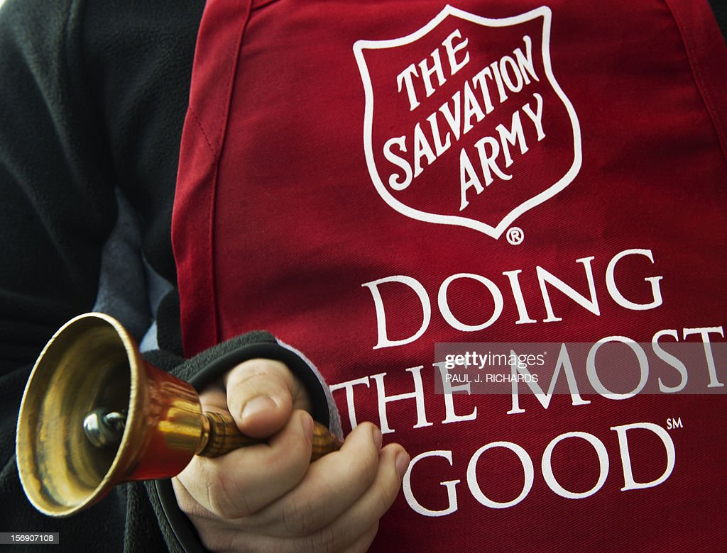 Salvation Army volunteer Bubba Wellens rings the collection bell outside a Giant grocery store November 24, 2012, in Clifton, Virgina. Salvation Army volunteers traditionally are seen collecting donations from holiday shopper for the needy between Thanksgiving and Christmas. AFP Photo/Paul J. Richards