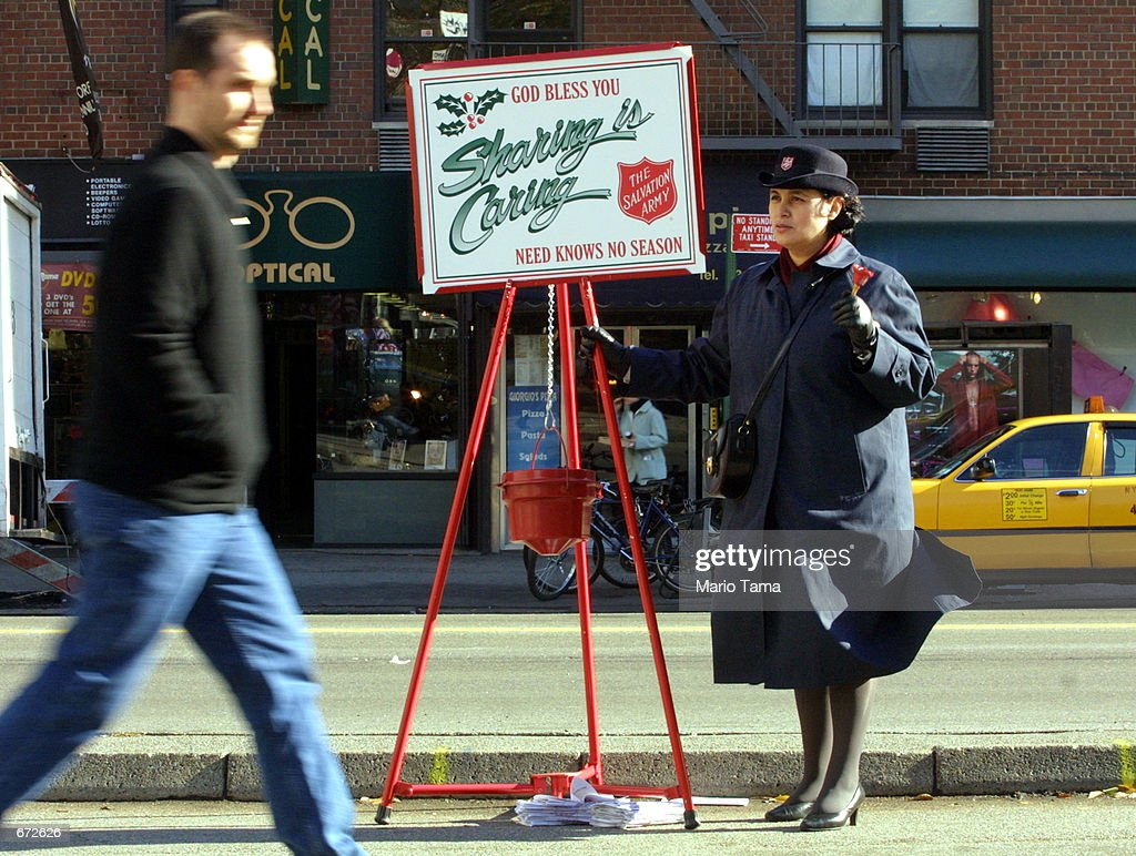 Salvation Army volunteer Teresa Valverde rings her bell while collecting donations November 20 2001 in New York City The Salvation Army's 2001...