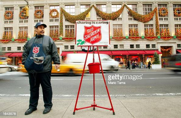 Salvation Army worker Yogi Lazu waits to collect money in front of the Saks Fifth Avenue store November 14 2002 in New York City Many stores in the...