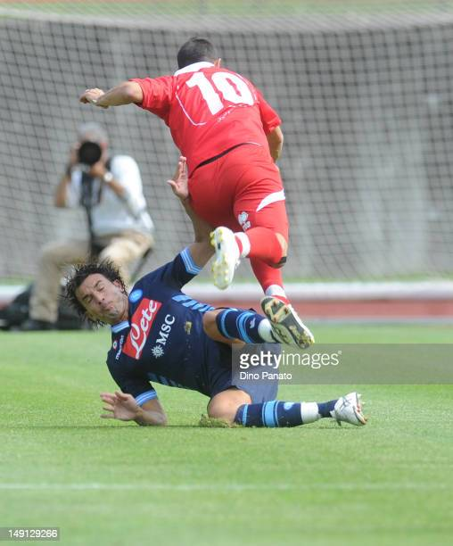 Salvatore Aronica of Napoli competes with Daniele Quadrini of Grosseto during the preseason friendly match between SSC Napoli and US Grosseto on July...