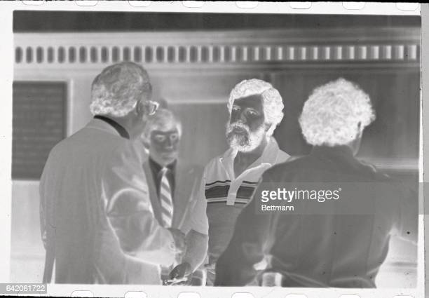 Salvatore 'Bill' Bonanno confers with his attorney Gerrold Ladar and unidentified counsel after he pleaded guilty in Alameda County Superior Court to...