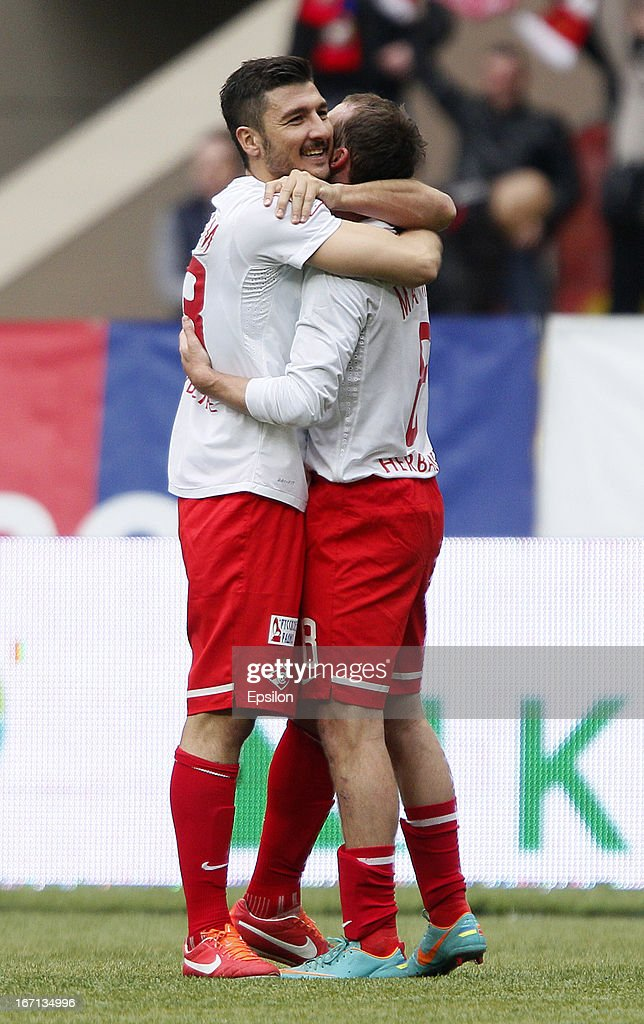 Salvatore Bocchetti and Aiden McGeady (R) of FC Spartak Moscow celebrate after scoring a goal during the Russian Premier League match between PFC CSKA Moscow and FC Spartak Moscow at the Luzhniki Stadium on April 21, 2013 in Moscow, Russia.