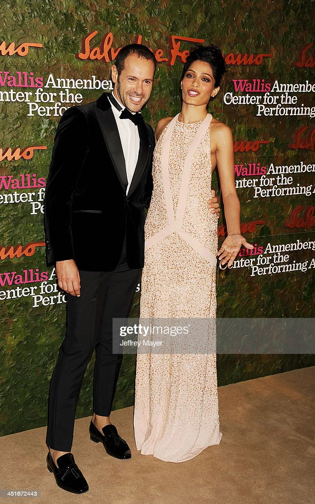 Salvatore Ferragamo Group Creative Director <a gi-track='captionPersonalityLinkClicked' href=/galleries/search?phrase=Massimiliano+Giornetti&family=editorial&specificpeople=3951751 ng-click='$event.stopPropagation()'>Massimiliano Giornetti</a> and actress <a gi-track='captionPersonalityLinkClicked' href=/galleries/search?phrase=Freida+Pinto&family=editorial&specificpeople=5518973 ng-click='$event.stopPropagation()'>Freida Pinto</a> arrive at the Wallis Annenberg Center For The Performing Arts Inaugural Gala at Wallis Annenberg Center for the Performing Arts on October 17, 2013 in Beverly Hills, California.