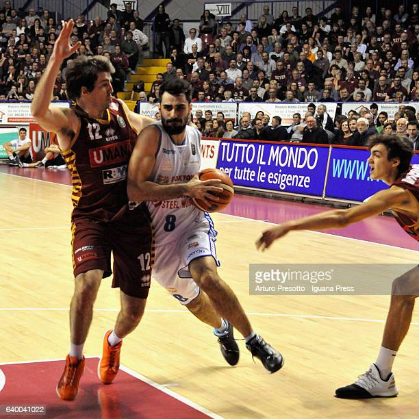Salvatore Parrillo of Red October competes with Ariel Filloy and Riccardo Visconti of Umana during the LegaBasket of Serie A1 match between Reyer...