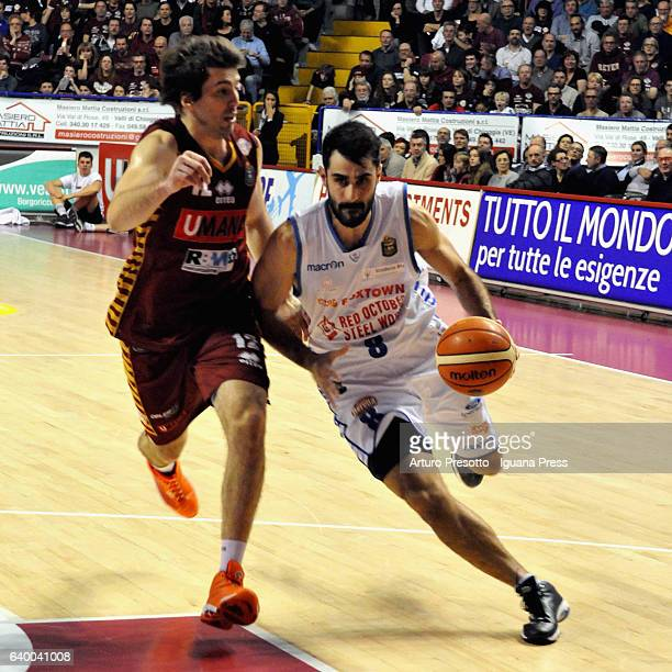 Salvatore Parrillo of Red October competes with Ariel Filloy of Umana during the LegaBasket of Serie A1 match between Reyer Umana Venezia and Red...