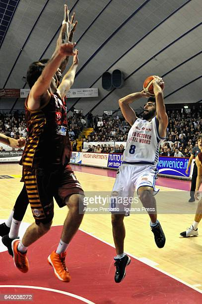 Salvatore Parrillo of Red October competes with Jamelle Hagins and Ariel Filloy of Umana during the LegaBasket of Serie A1 match between Reyer Umana...