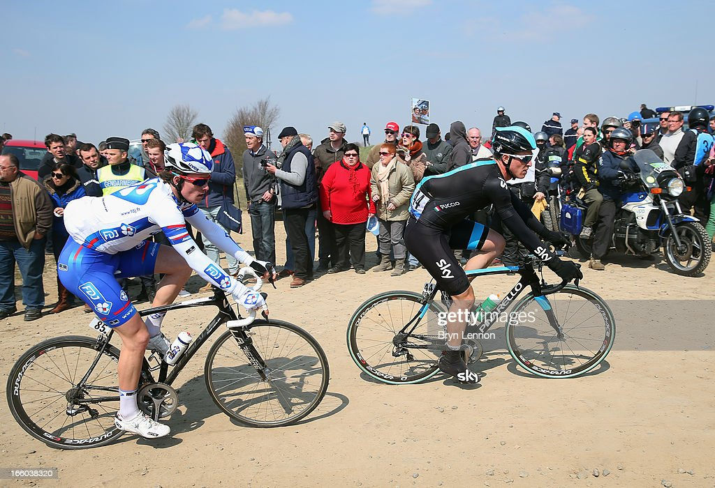 Salvatore Puccio of Italy and SKY Procycling leads Arnald Demare of France and FDJ during the 2013 Paris - Roubaix race from Compiegne to Roubaix on April 7, 2013 in Roubaix, France. The 111th Paris - Roubaix race is 254km long and contains 27 sections of cobblestones.