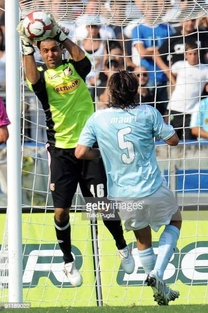 Salvatore Sirigu goalkeeper of US Citta di Palermo holds the ball as Stefano Mauri of Lazio looks on during the Serie A match played between SS Lazio...