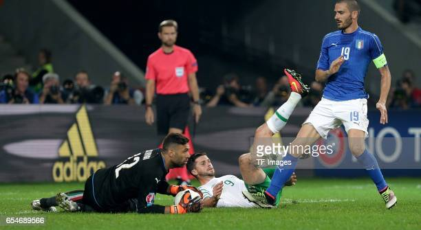 Salvatore Sirigu of Italy and Shane Long of Ireland and Leonardo Bonucci of Italy battle for the ball during the UEFA Euro 2016 Group E match between...