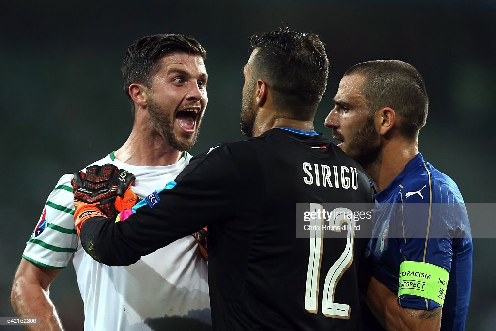 <a gi-track='captionPersonalityLinkClicked' href=/galleries/search?phrase=Salvatore+Sirigu&family=editorial&specificpeople=5969515 ng-click='$event.stopPropagation()'>Salvatore Sirigu</a> of Italy clashes with <a gi-track='captionPersonalityLinkClicked' href=/galleries/search?phrase=Shane+Long&family=editorial&specificpeople=661194 ng-click='$event.stopPropagation()'>Shane Long</a> of Republic of Ireland during the UEFA Euro 2016 Group E match between Italy and Republic of Ireland at Stade Pierre-Mauroy on June 22, 2016 in Lille, France.