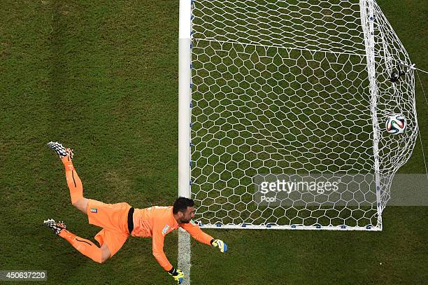 Salvatore Sirigu of Italy fails to stop Daniel Sturridge of England's goal during the 2014 FIFA World Cup Brazil Group D match between England and...