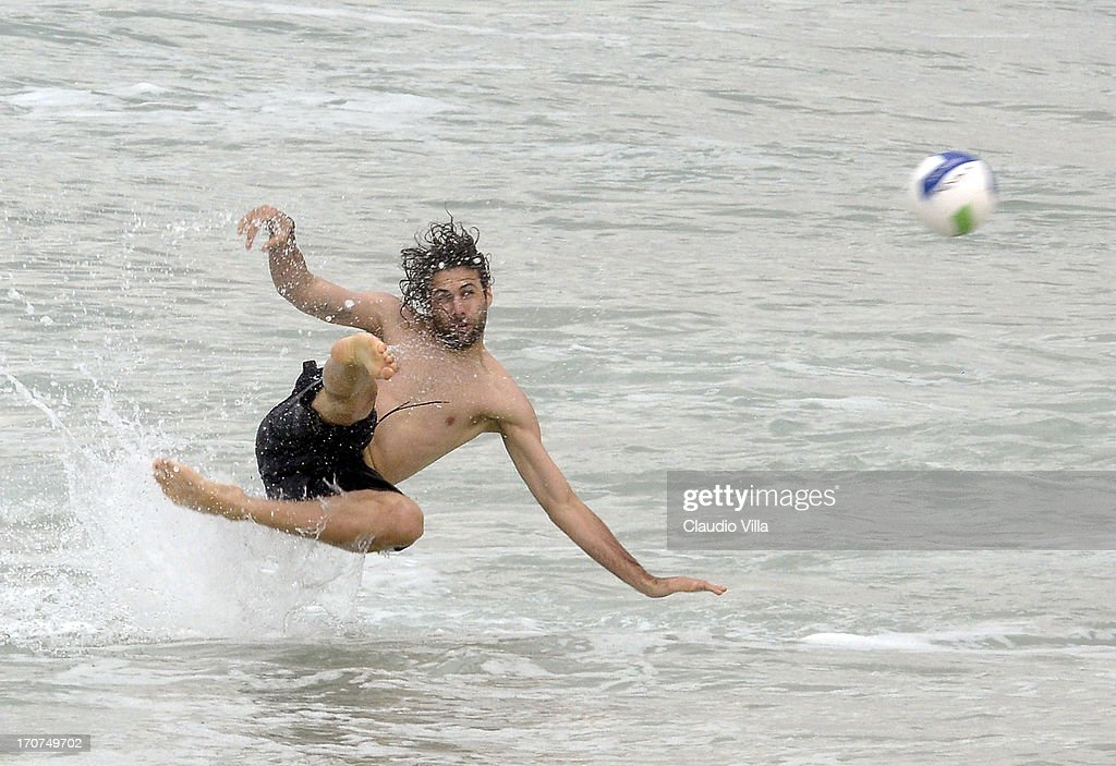<a gi-track='captionPersonalityLinkClicked' href=/galleries/search?phrase=Salvatore+Sirigu&family=editorial&specificpeople=5969515 ng-click='$event.stopPropagation()'>Salvatore Sirigu</a> of Italya play volleyball at the Barra de Tijuca beach on June 17, 2013 in Rio de Janeiro, Brazil.