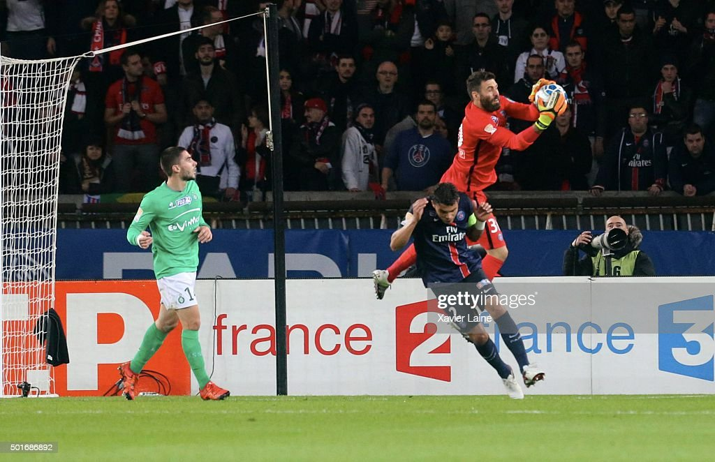 Salvatore Sirigu of Paris Saint-Germain catch the ball over Thiago Silva during the French League Cup between Paris Saint-Germain and AS Saint Etienne at Parc Des Princes on december 16, 2015 in Paris, France.