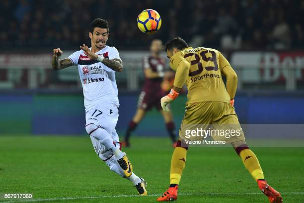 Salvatore Sirigu of Torino FC in action against Diego Farias of Cagliari Calcio during the Serie A match between Torino FC and Cagliari Calcio at...