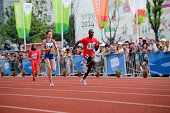 Salwa Naser of Bahrain Ioana Teodora Gheorghe of Romania and Sydney Siame of Zambia complete in the 8x100m Mixed Team Relay Final at Yanshan Road AT...