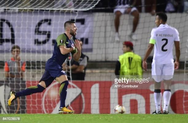 Salzbourg's midfielder from Norway Valon Berisha celebrates a goal during the Europa League football match Vitoria Guimaraes SC vs FC Red Bull...