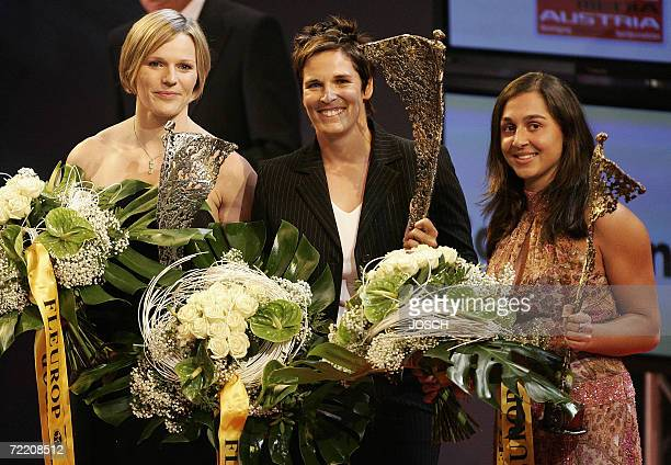 Austria's sports women of the year Michaela Dorfmeister celebrates with second placed Marlies Schild and third placed Tamira Paszek in the 'Salzburg...