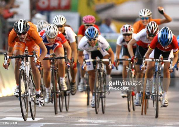 Ductch Marianne Vos crosses the finish line of the Women's road race at the 2006 UCI world road championships 23 September 2006 in Salzburg Marianne...