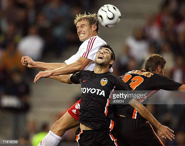 Valencia's Raul Albiol Tortajado and Salzburg's Alexander Zickler challenge for the ball during a Champions League third leg qualifying match between...