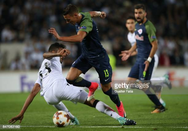Salzburg forward Hannes Wolf from Austria with Jubal Junior in action during the UEFA Europa League match between Vitoria de Guimaraes and RB...
