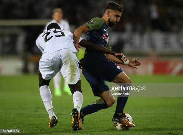Salzburg forward Munas Dabbur from Greece with Vitoria Guimaraes midfielder Alhassan Wakaso from Ghana in action during the UEFA Europa League match...