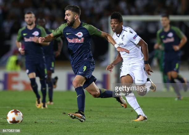 Salzburg forward Munas Dabbur from Greece with Vitoria Guimaraes midfielder Heldon from Brazil in action during the UEFA Europa League match between...