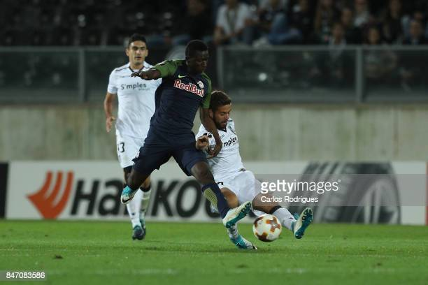 Salzburg midfielder Diadie Samassekou from Mali vies with Guimaraes midfielder Kiko from Portugal for the ball possession during the match between...