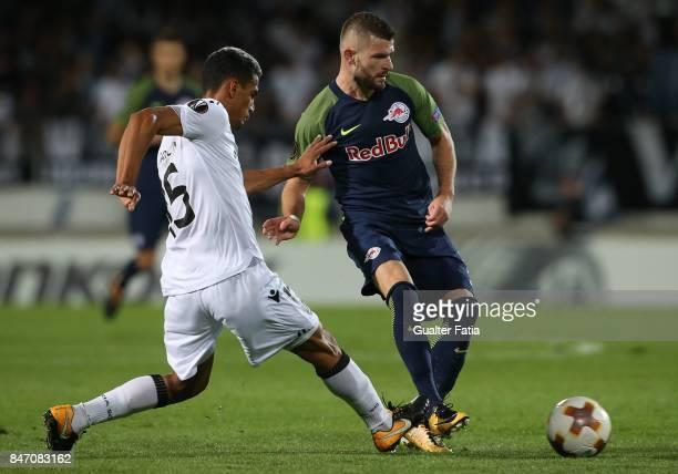 Salzburg midfielder Valon Berisha from Kosovo with Vitoria Guimaraes defender Victor Garcia from Venezuela in action during the UEFA Europa League...